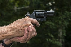 Hands aiming a pistol
