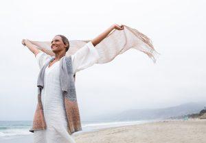 happy woman on windy beach