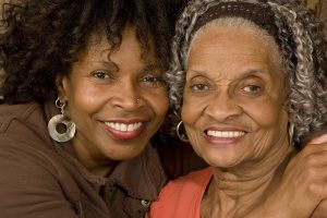 happy adult daughter with Alzheimer's mother