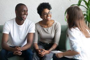 happy siblings talking with mediator