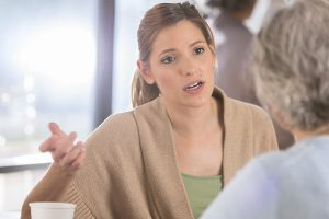 daughter discussing overstepping boundaries with senior parents